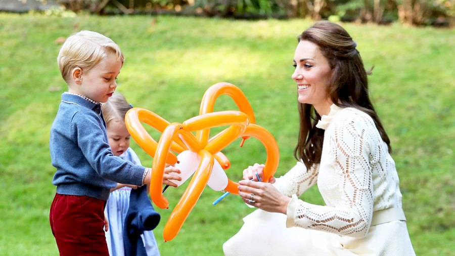 Kate Middleton with Princess Charlotte and Prince George at a children's party for Military families during the 2016 Royal Tour of Canada in Victoria, Canada.