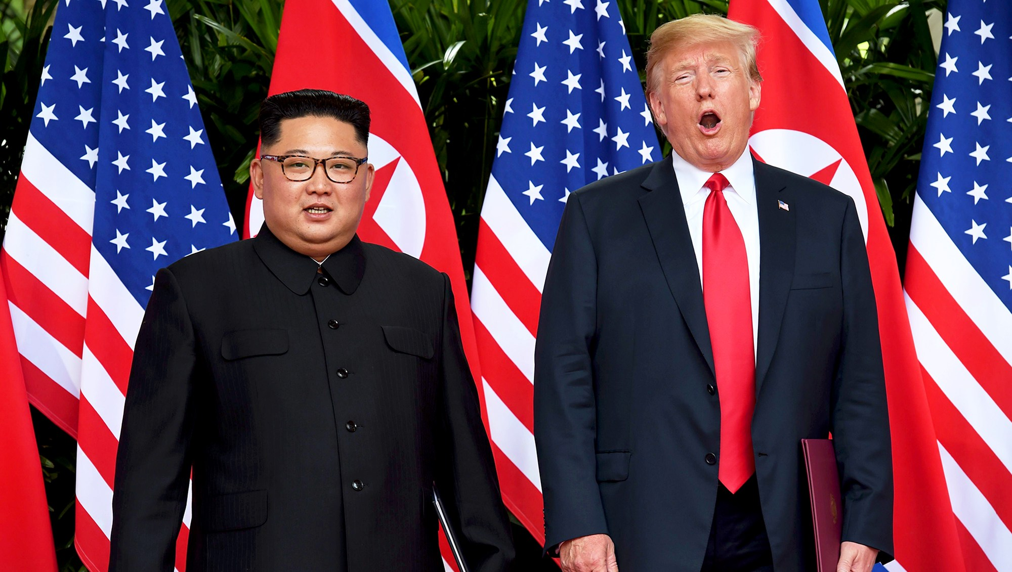 Kim Jong Un and Donald Trump after taking part in a signing ceremony at the end of their historic U.S.-North Korea summit at the Capella Hotel on Sentosa island in Singapore on June 12, 2018.