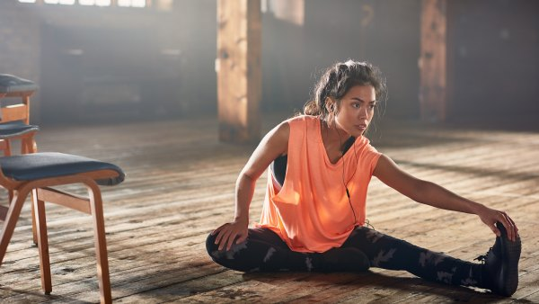 Woman stretching with earbuds