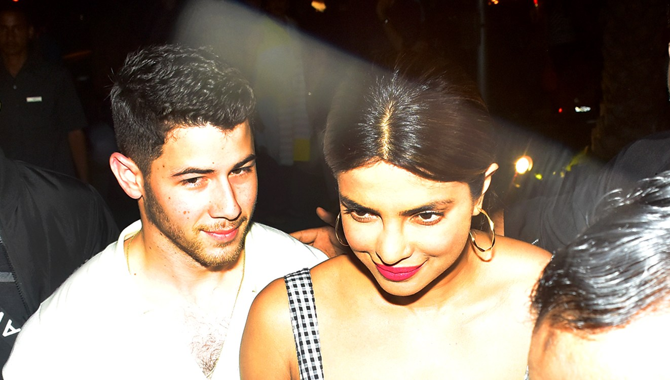 Nick Jonas and Priyanka Chopra walking through the streets of Mumbai on June 22, 2018.