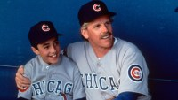 Thomas Ian Nicholas on dugout bench with Gary Busey in a scene from the film 'Rookie Of The Year', 1993.