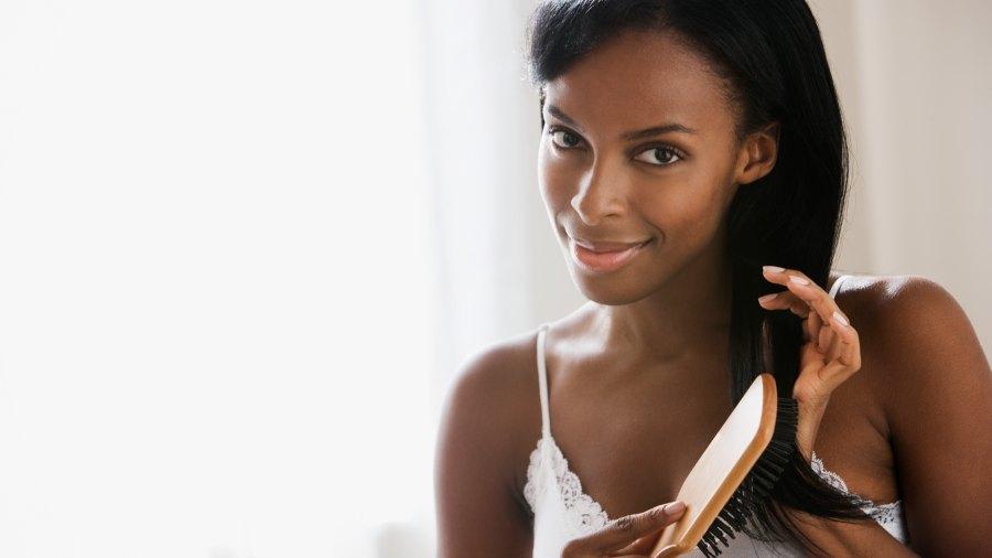 black woman brushing her hair