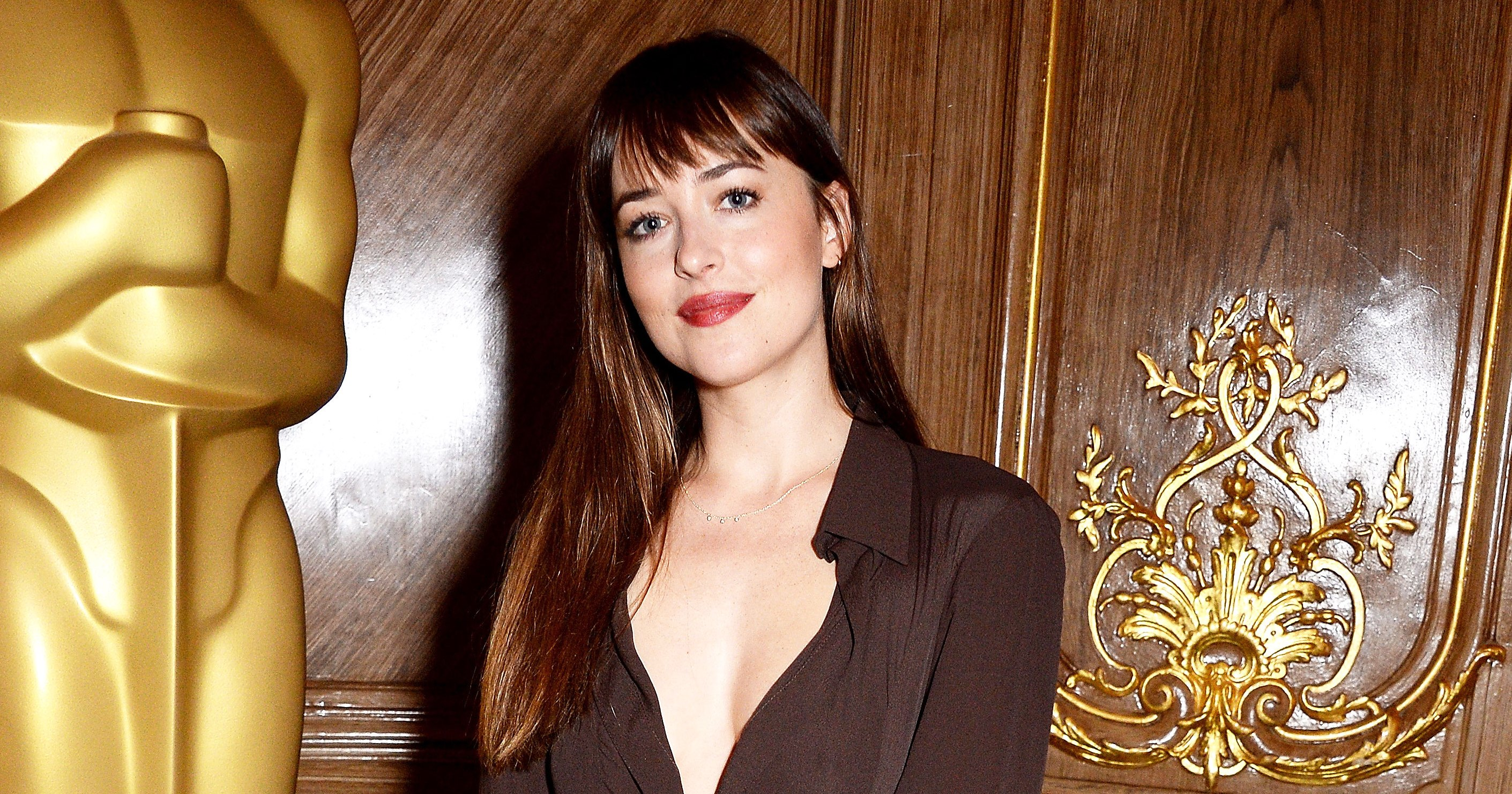 Dakota Johnson Gives Her Caftan a Fall Twist at an Academy of Motion Pictures Luncheon