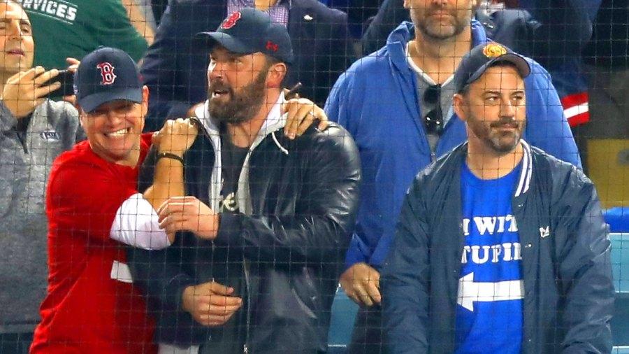 Jimmy Kimmel (R) looks on as Matt Damon and Ben Affleck celebrate the Boston Red Sox winning the World Series v The Los Angeles Dodgers.