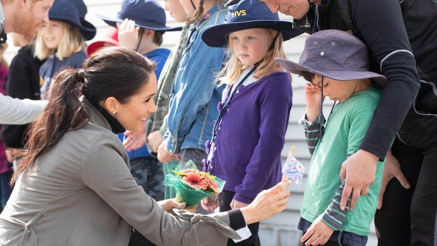 Meghan, Duchess of Sussex meets children