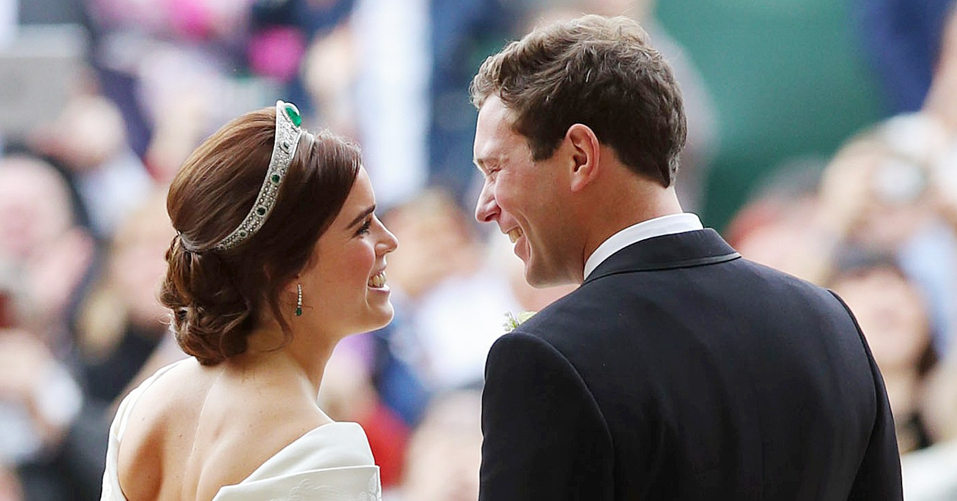 Britain's Princess Eugenie of York (L) and her husband Jack Brooksbank kiss as they emerge from the West Door of St George's Chapel, Windsor Castle, in Windsor, on October 12, 2018 after their wedding ceremony. YUI MOK/AFP/Getty Images