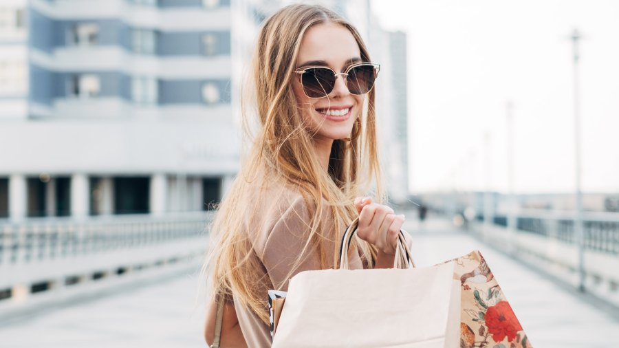 Portrait of a smiling woman carrying shopping bags