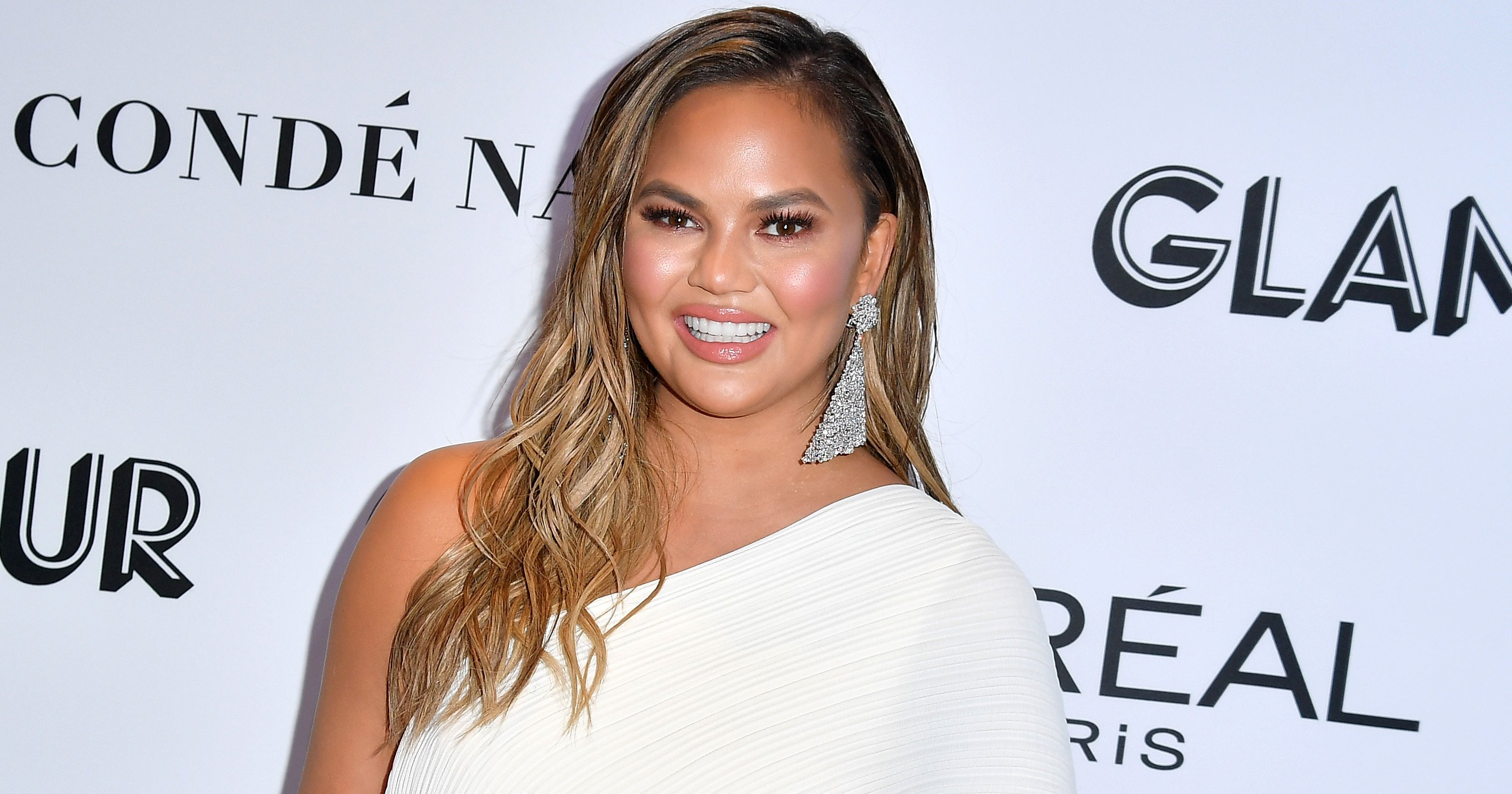 Chrissy Teigen Shares New Pic of Kids Luna, Miles in Red Sneakers