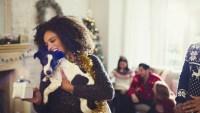 Woman holding dog and Christmas gift