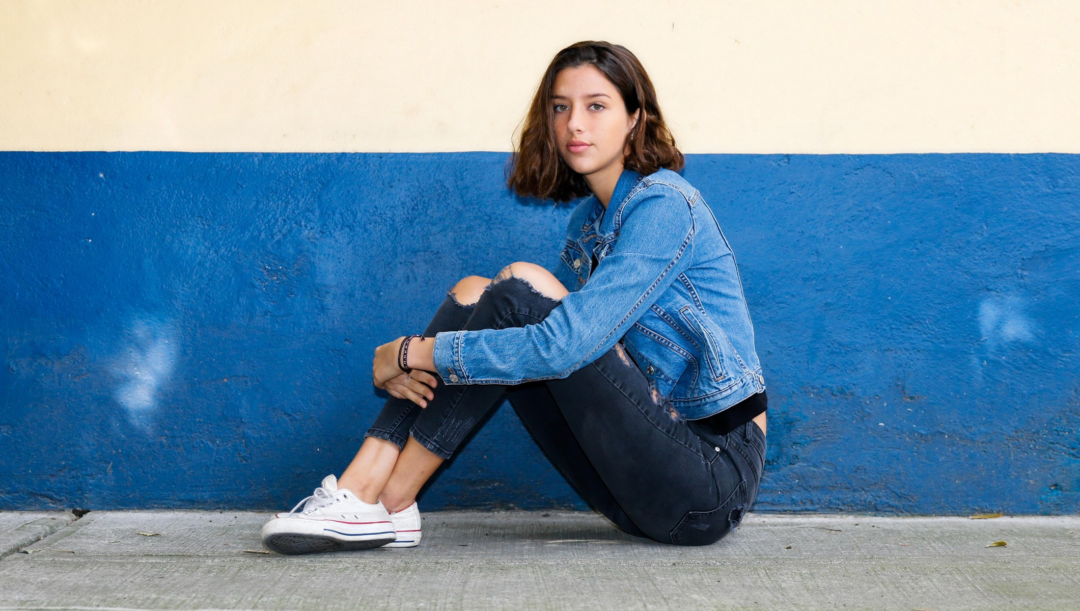 girl in a pair of jeans and a denim jacket