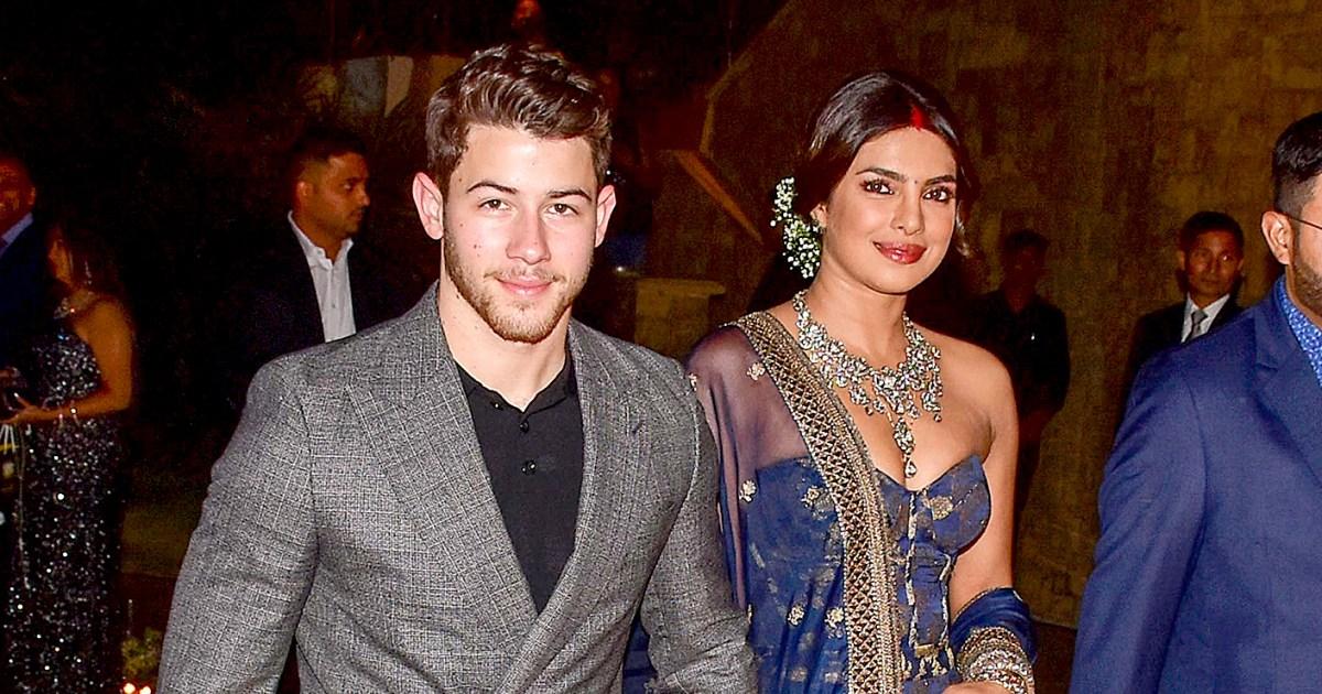 Nick Jonas Priyanka Chopra Look In Love At Mumbai Wedding Reception