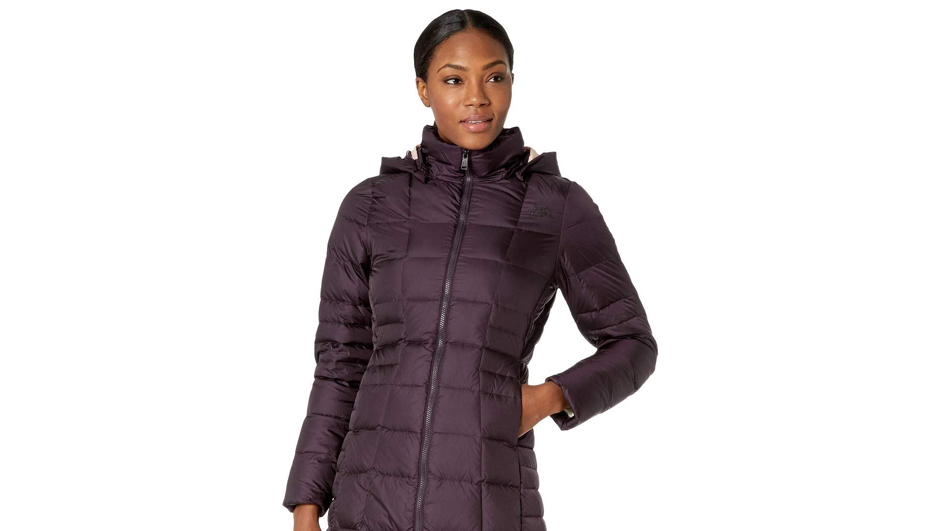 woman wearing a purple north face puffer coat