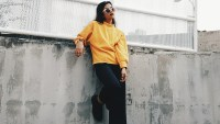 Full Length Of Woman In Yellow Sweater