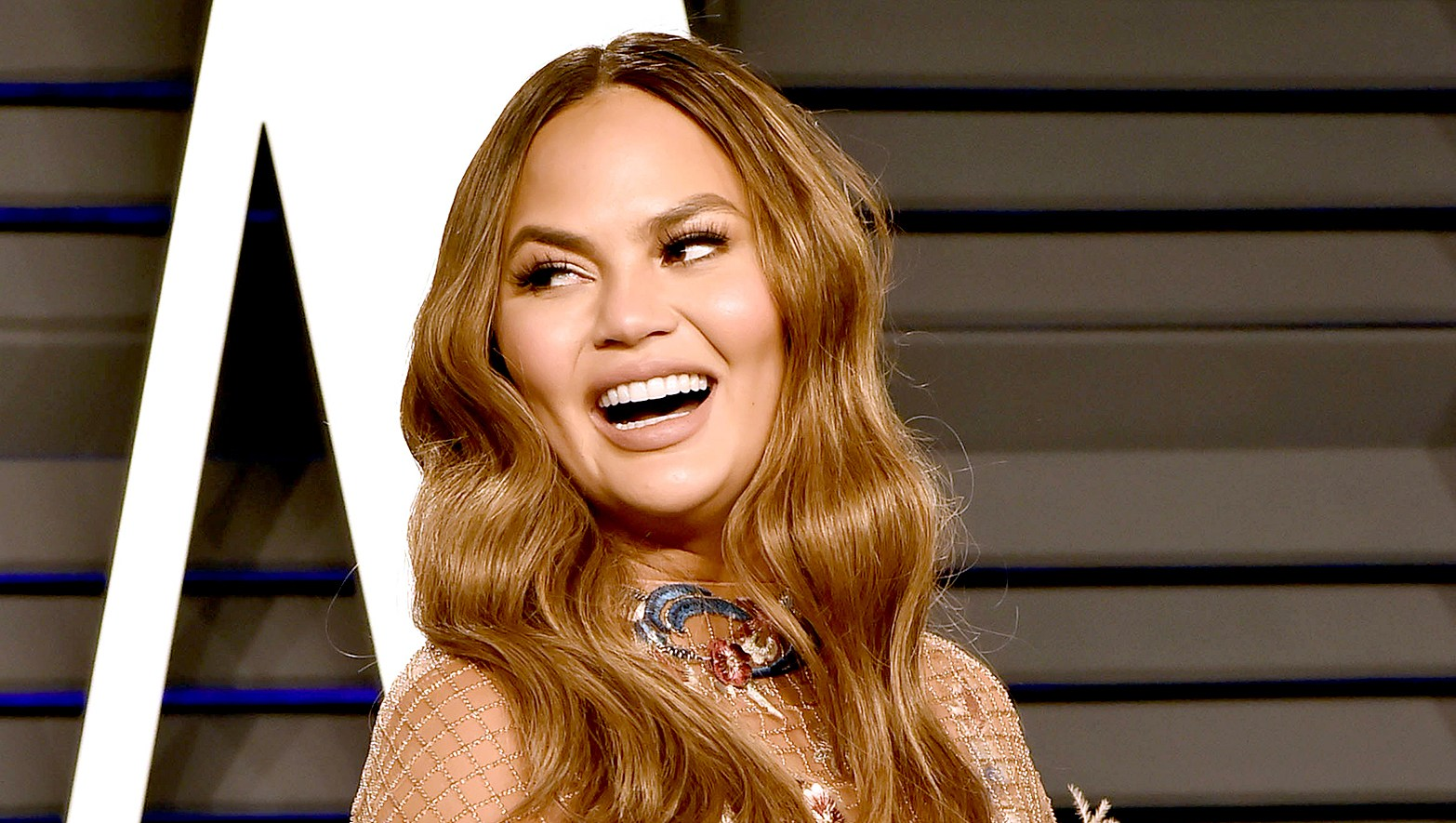 Chrissy-Teigen-Pokes-Fun-at-College-Admissions-Scam-With-Photoshop