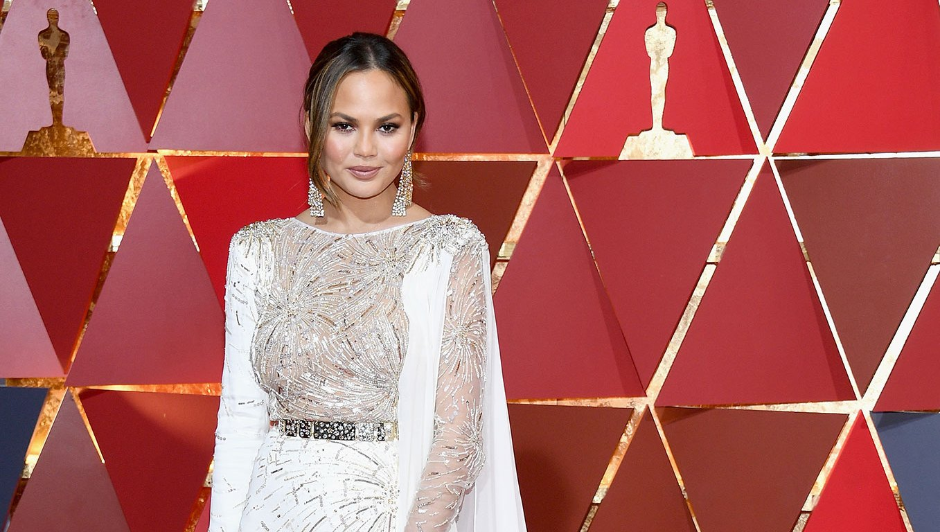 Chrissy Teigen Claps Back at Troll Who Says 'Nobody Cares' About Her Kids