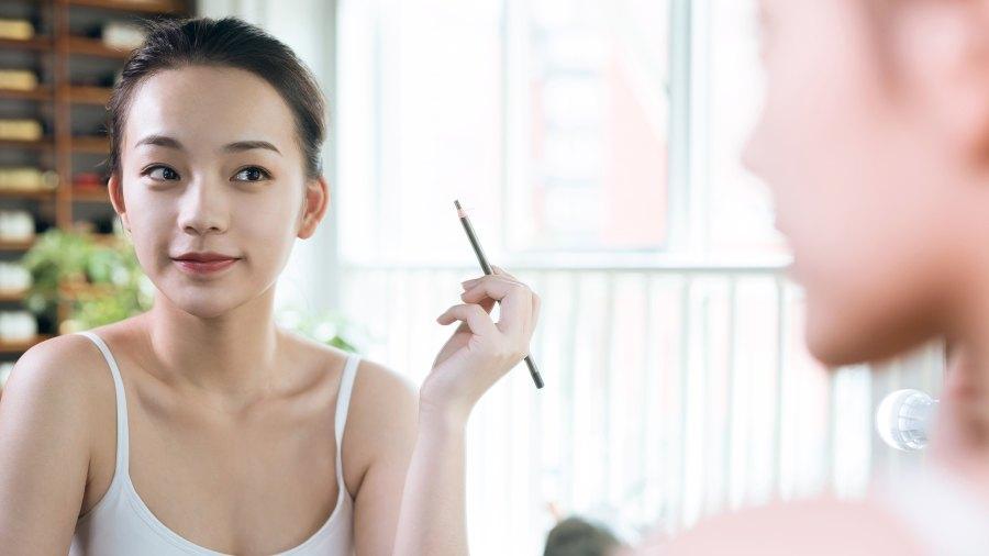 Woman Using Eye Pencil