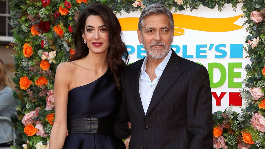 George Clooney Amal Clooney Off of Motorcycles People's Postcode Lottery Charity Gala