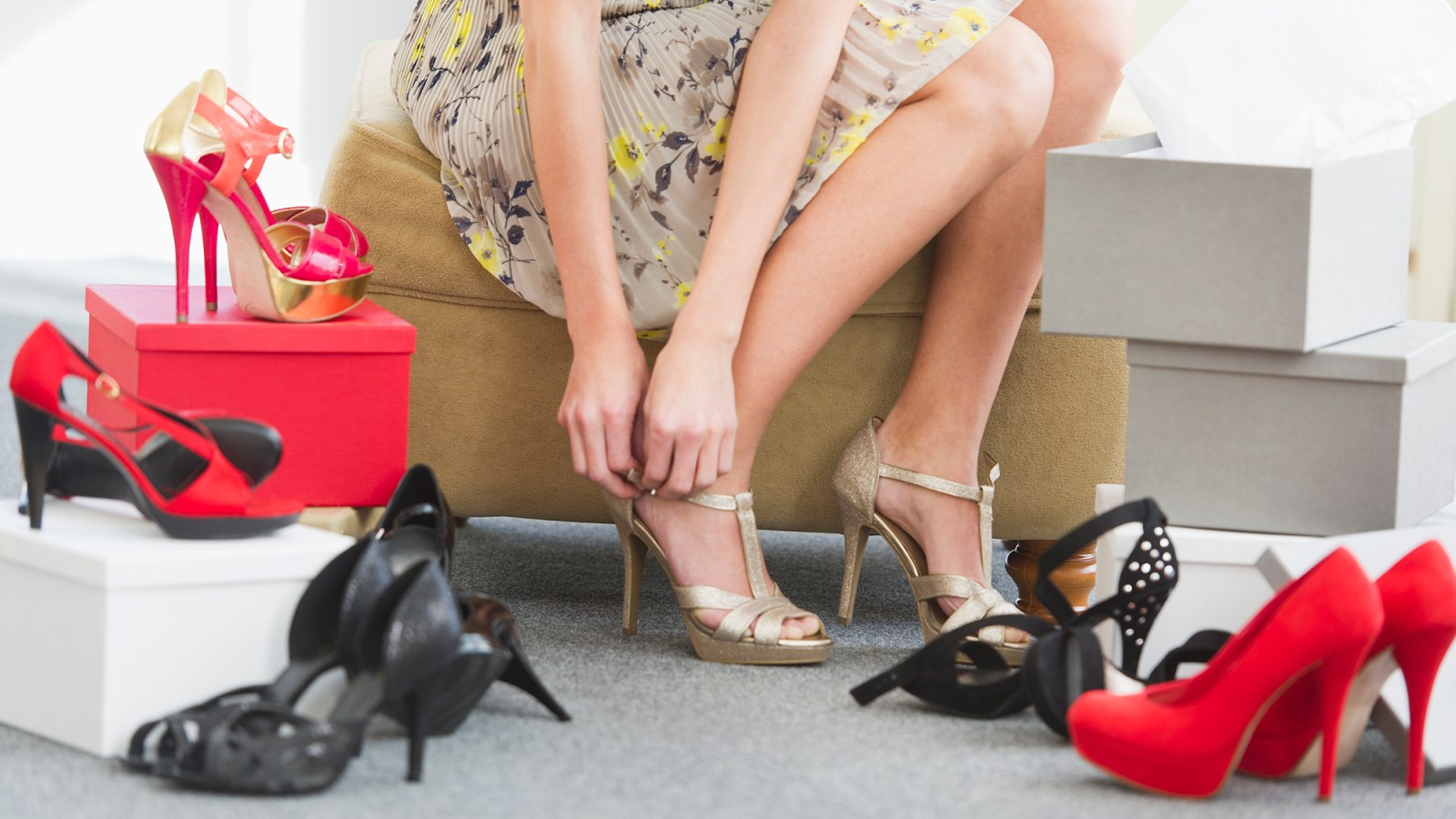 57c4fa9e6d The 5 Best Deals in the Amazing Stuart Weitzman Sale for Memorial Day. By  Suzy Forman. Woman Trying on Shoes