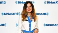 Bella Thorne Wearing A White and Blue Chanel Shirt and Jeans With White Heels