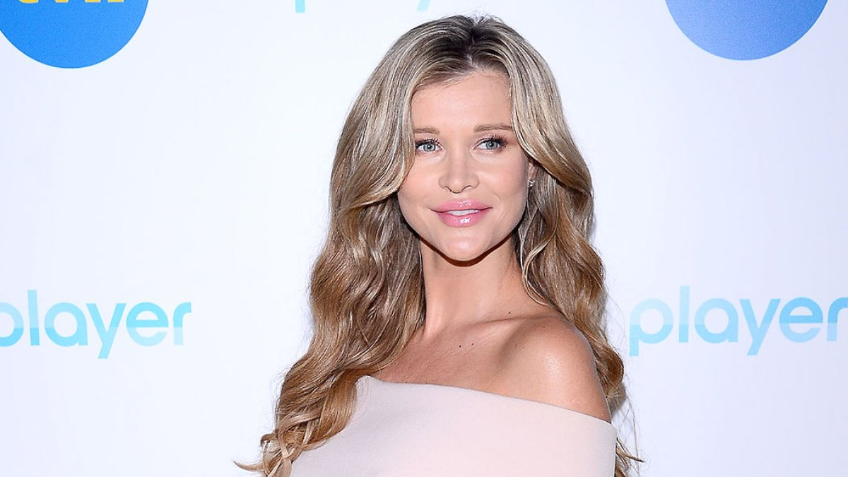 Pregnant Joanna Krupa Uses Rescue Dogs to Reveal Baby's Sex