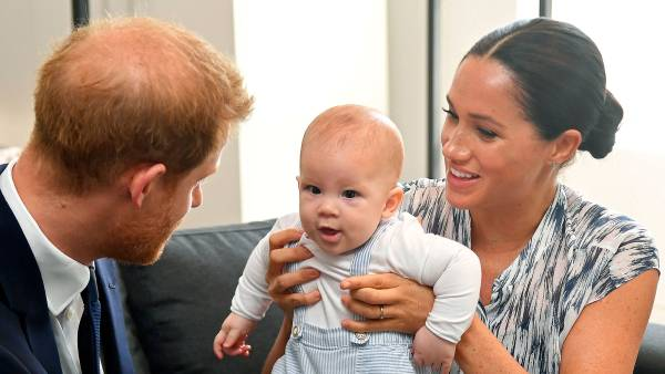 Prince Harry and Meghan Duchess of Sussex, holding their son Archie Harrison Mountbatten-Windsor