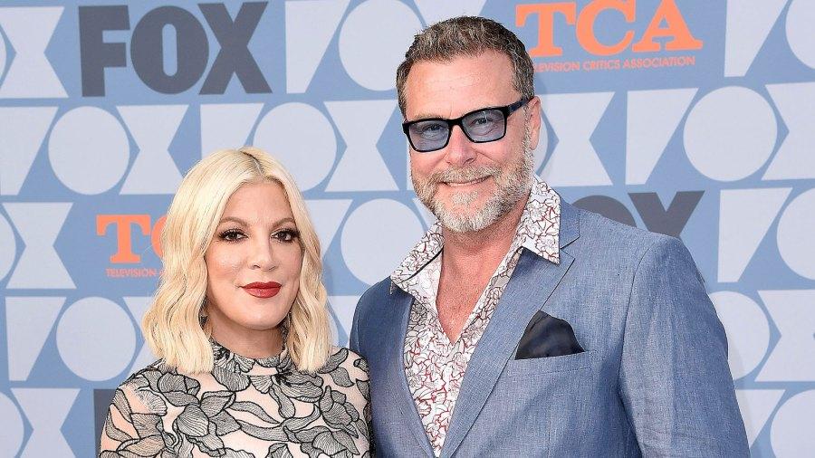 Tori Spelling and Dean McDermott Blue jacket Blue Glasses
