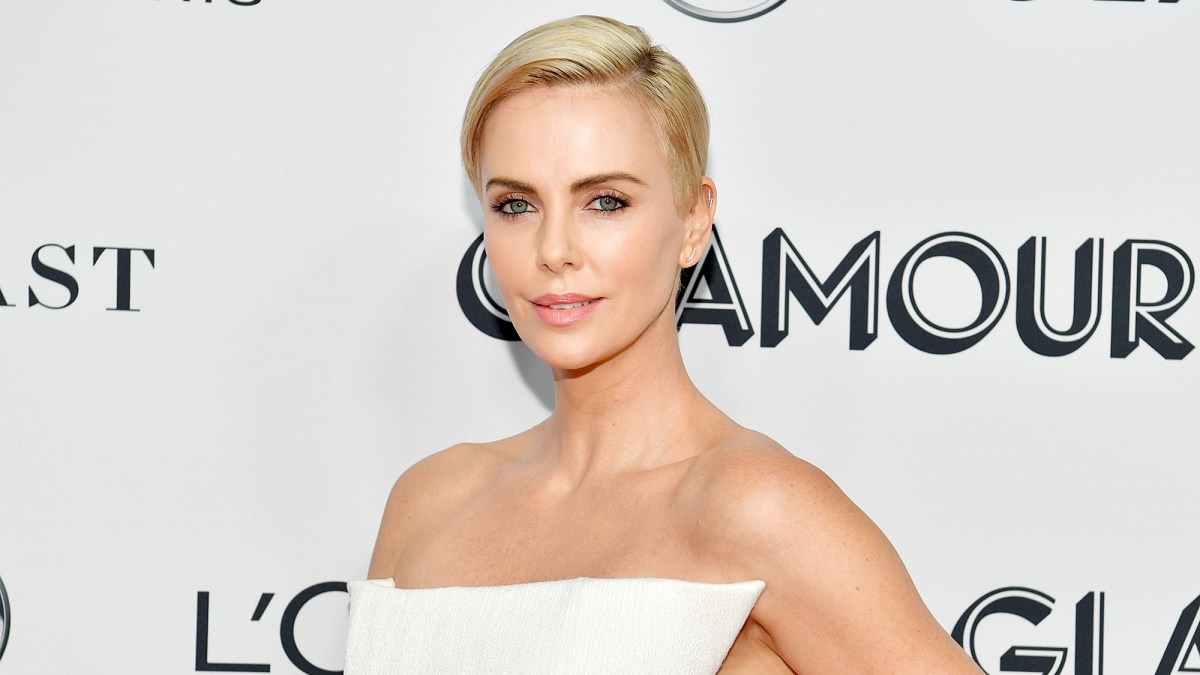 Charlize Theron: How Caring for 2 Puppies Is Making My Kids 'Better People'