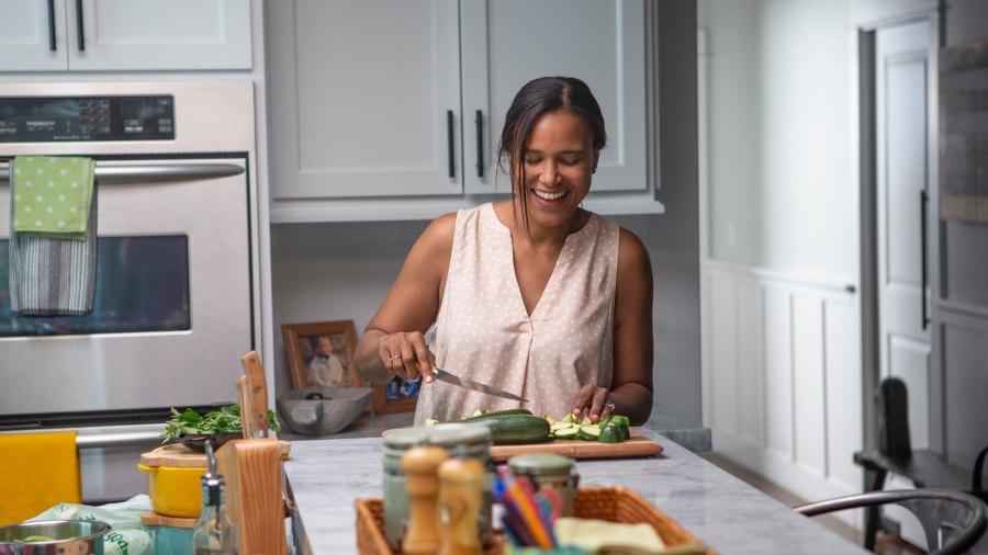 woman preparing food in her kitchen