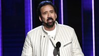 Nicolas Cage Packs on PDA With Mystery Woman at Independent Spirit Awards