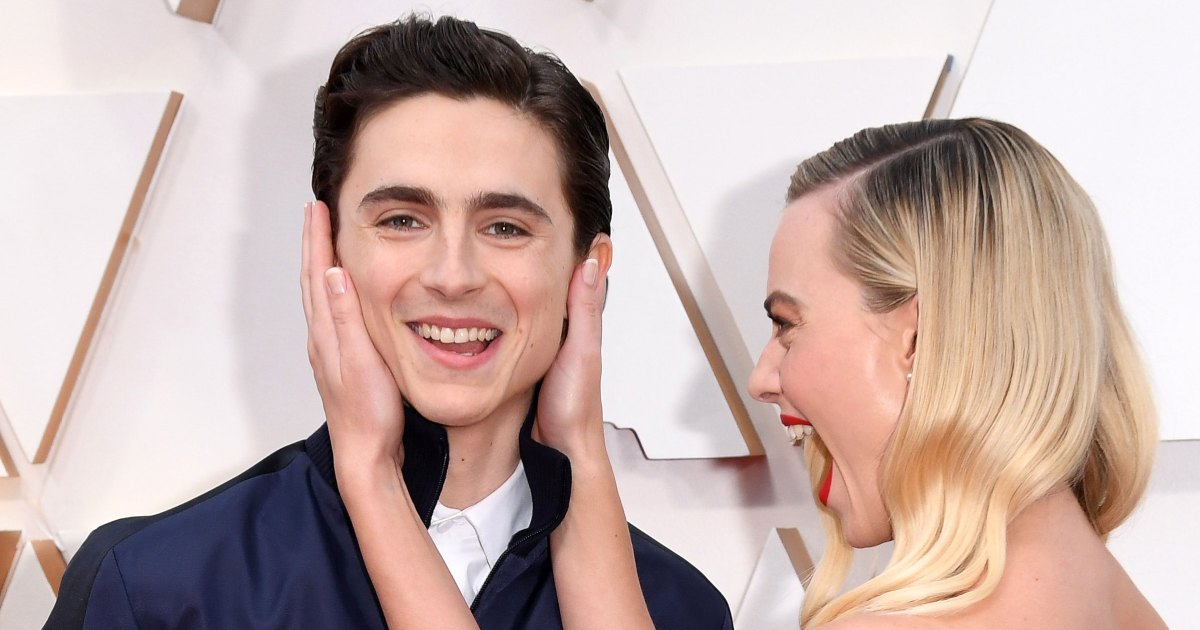 Oh, Snap! Timothee Chalamet Photobombs Margot Robbie on Oscars Red Carpet