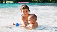 Penelope Disick playing with Psalm West in a Palm Springs pool