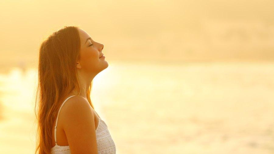 woman-breathing-fresh-air