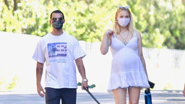Pregnant Sophie Turner Cradles Her Baby Bump on a Walk With Joe Jonas