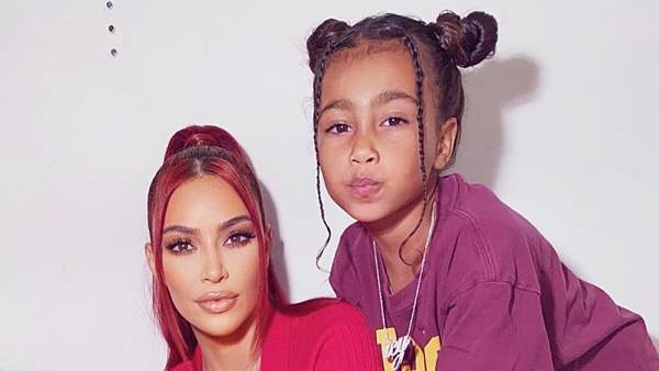 Saint West Kim Kardashian Wearing Red and with Red Hair and North West