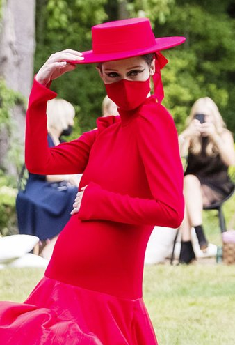 Pregnant Coco Rocha Turns Heads on the Christian Siriano NYFW Runway Showing Off Her Baby Bump in a Red Gown