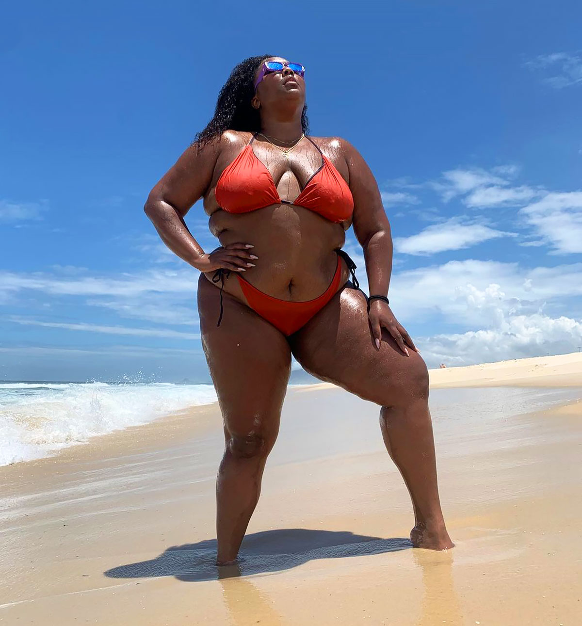 7 of Lizzo's Hottest Swim Moments of All Time