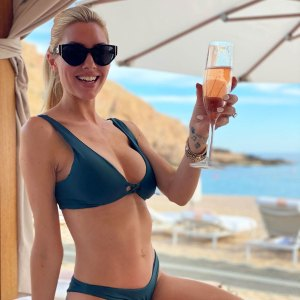 Heather Rae Young Kicks Off Her Holiday Vacation in Super Stylish Bikini