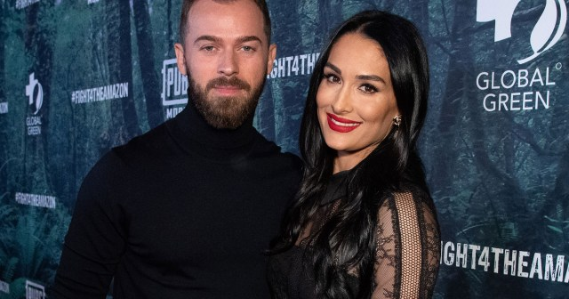 Nikki Bella, Artem Chigvintsev and Son Matteo Celebrate 1st Christmas as a Family With Holiday Card Photo Shoot.jpg