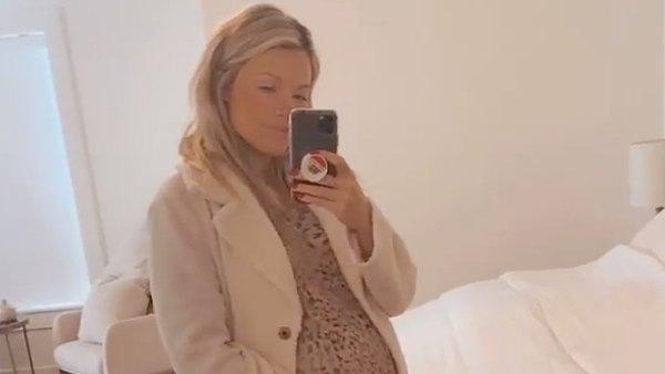 Witney Carson baby bump leopard dress