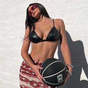 Kylie Jenner Shows Off Washboard Abs in Skimpy Latex Bikini