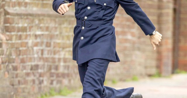 Harry Styles Transforms Into a '50s Cop While Filming 'My Policeman' — and Twitter Is in Love.jpg