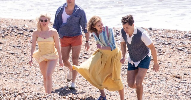 Harry Styles, Emma Corrin and David Dawson Skip Down the Beach on 'My Policeman' Set: Pics.jpg