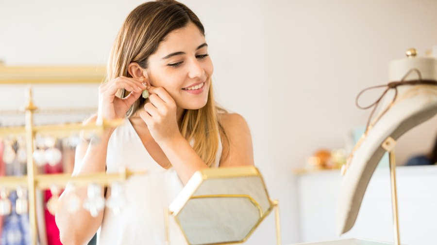 Woman-Trying-On-Jewelry-Stock-Photo