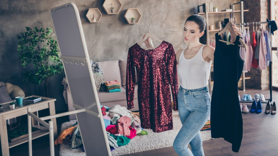 Woman-Getting-Dressed-Stock-Photo