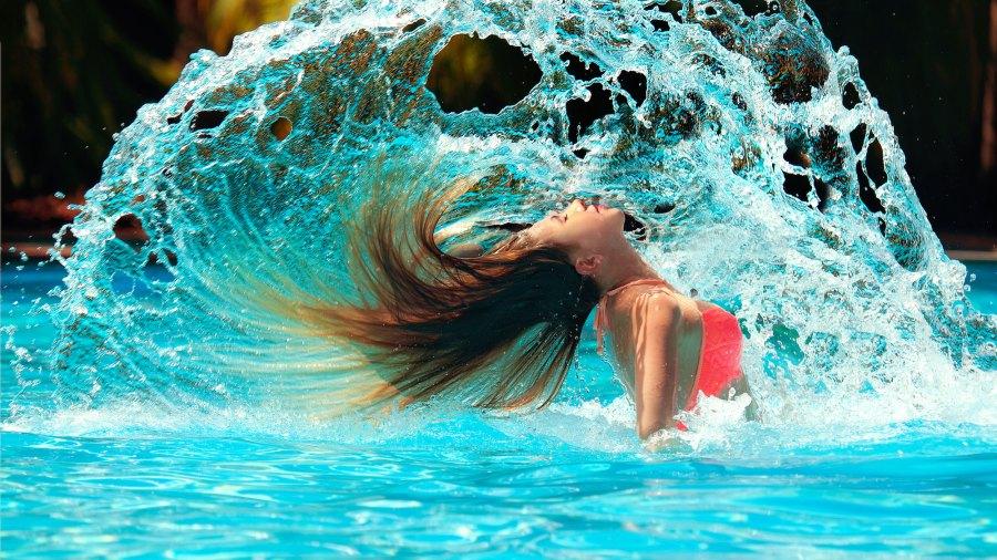 Woman-In-Pool-Stock-Photo