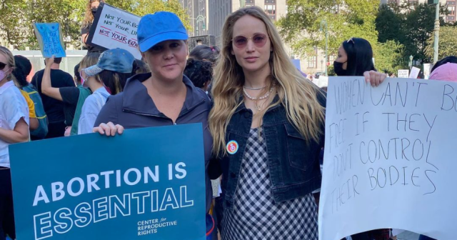 Jennifer Lawrence Shows Baby Bump at Women's March With Amy Schumer: See Her Homemade Sign.jpg