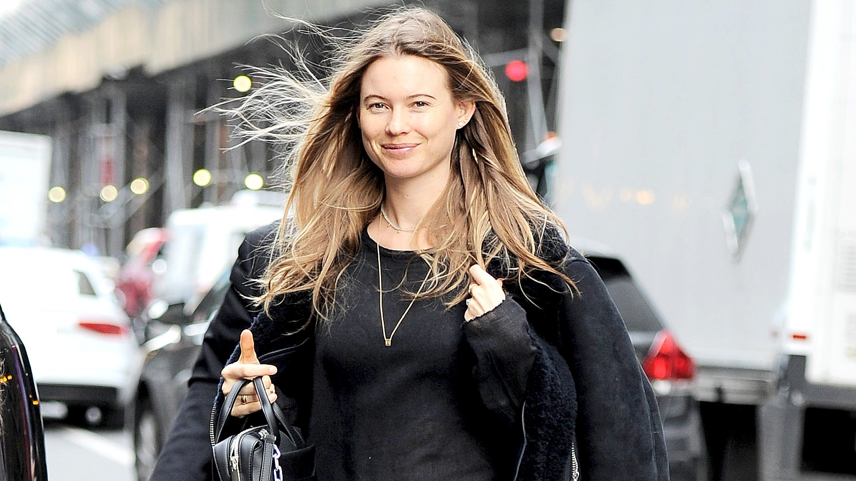Behati Prinsloo is all smiles as she steps out to head to Dujour magazine event in NYC on March 23, 2016.