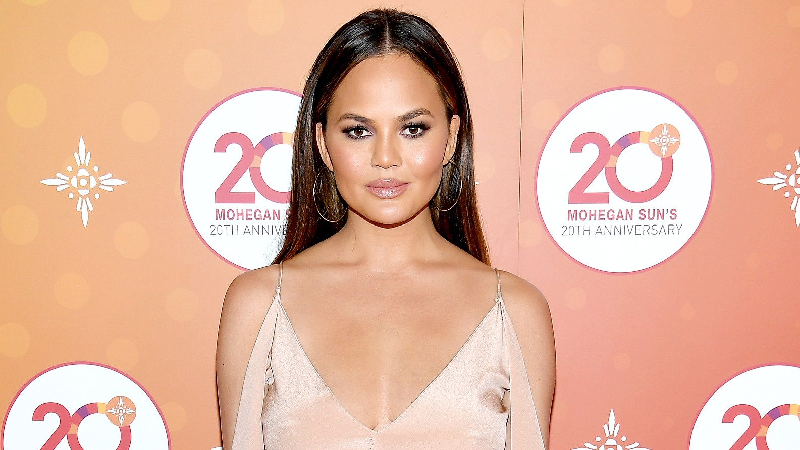 Chrissy Teigen walks the red carpet before the Ballroom After Party with Chrissy Teigen and LL Cool J for Mohegan Sun's 20th Anniversary at Mohegan Sun on October 15, 2016 in Uncasville, Connecticut.