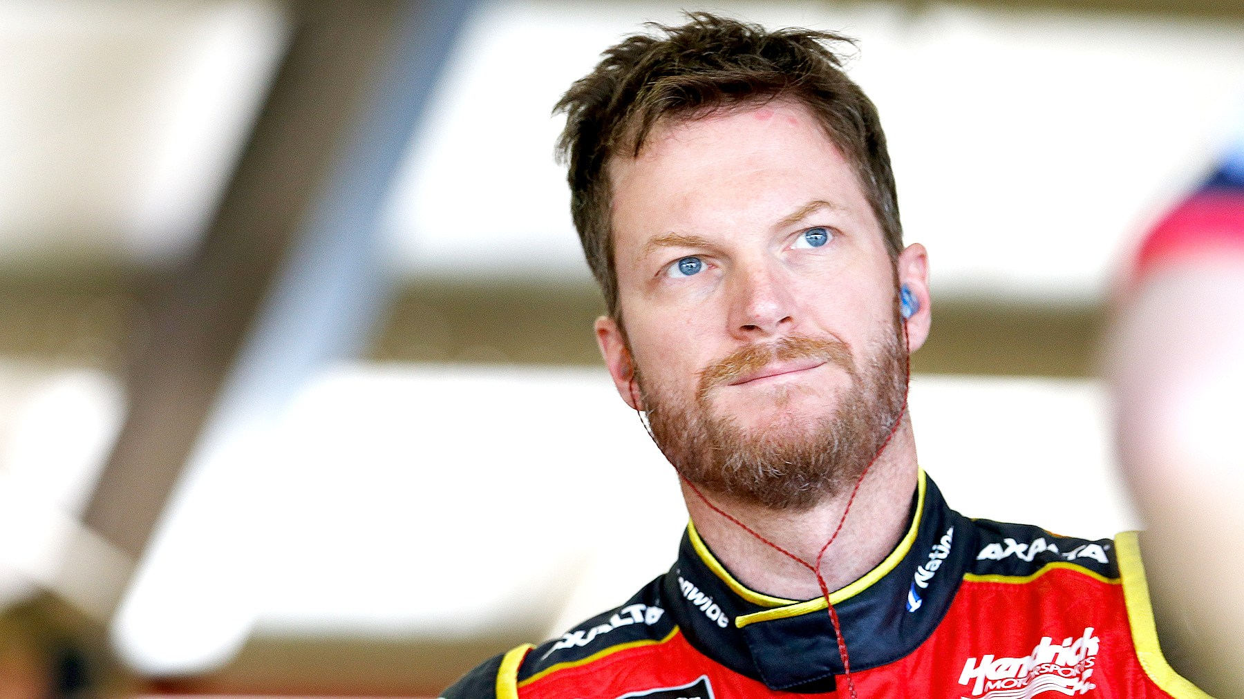 Dale Earnhardt Jr, driver of the #88 Axalta Chevrolet, stands in the garage during practice for the Monster Energy NASCAR Cup Series Auto Club 400 at Auto Club Speedway on March 24, 2017 in Fontana, California.