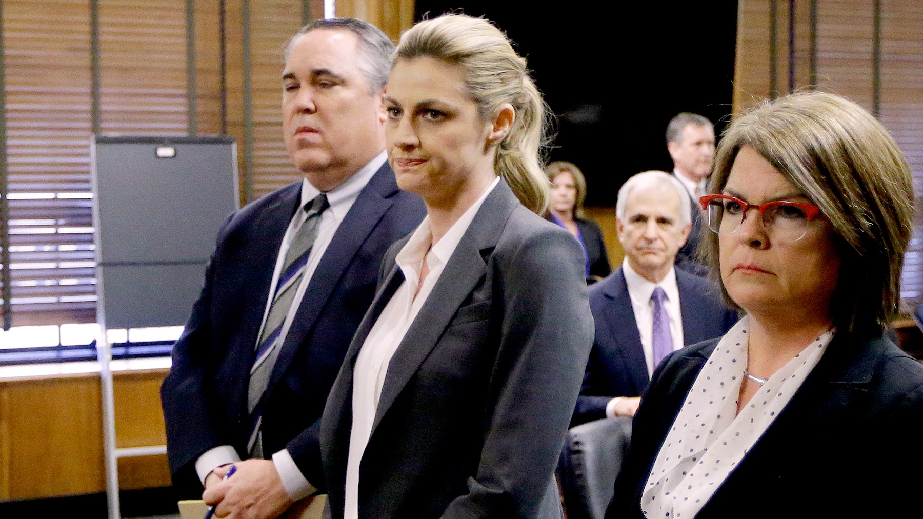 Erin Andrews stands with attorney Scott Carr, second from left, as the jury arrives in the courtroom after reaching a verdict Monday, March 7, 2016, in Nashville, Tenn.